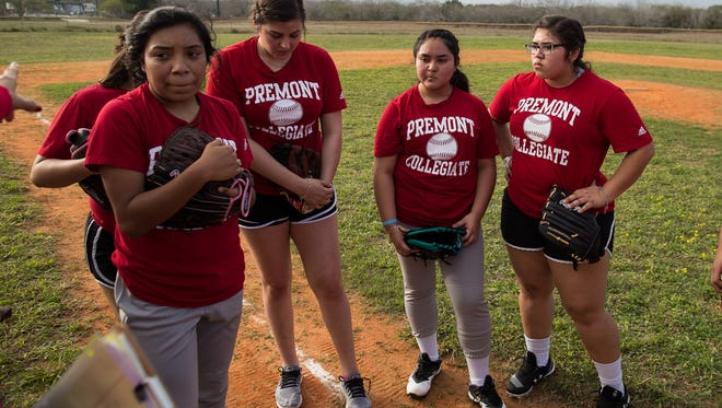 Premont softball players huddle during practice on Wednesday, Feb. 14, 2018.