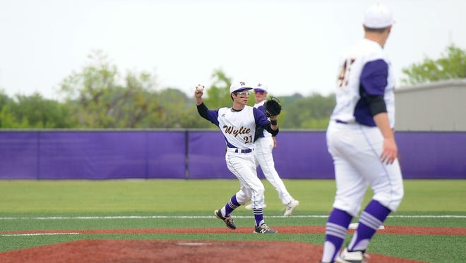 Wylie shortstop Gatlin Martin (21) sets to throw to first during the Bulldogs' 6-2 win against Brownwood on Friday, April 20, 2018.
