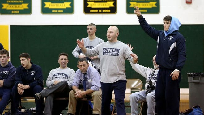 Suffern wrestling coach Chris Matteotti during a meet against East Ramapo at Ramapo High School, Jan. 13, 2016 in Spring Valley.