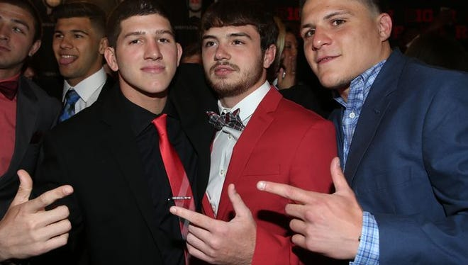 Rutgers wrestlers Anthony Ashnault, Scott DelVecchio and Anthony Perrotti, left to right, celebrated at the R Awards ceremony and red carpet.