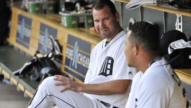 Tigers pitcher Mike Pelfrey, left, talks to Miguel Cabrera after Cabrera hit a homer out of Comerica Park in the first inning against the Mariners Monday.