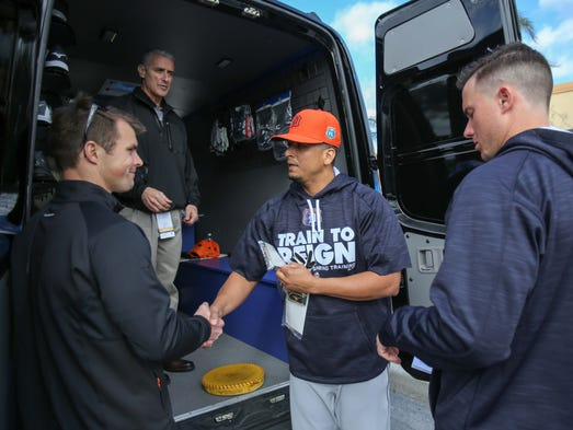Tigers Victor Martinez shakes hands with Mizuno Brand