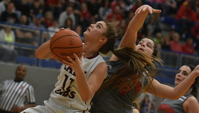 Cheatham County's Josie Bumpus eyes the basket as Westmoreland's Karley Smith defends during Tuesday's District 9-AA Tournament championship game.