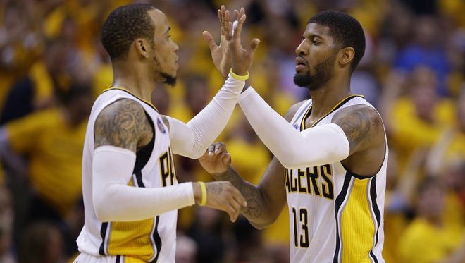 Indiana Pacers forward Paul George (13) and guard Monta Ellis (11) react as the team extends their lead over the Toronto Raptors during the second half of game 6 in an NBA basketball playoff game, Friday, April 29, 2016, at Bankers Life Fieldhouse. Pacers won 101-83.