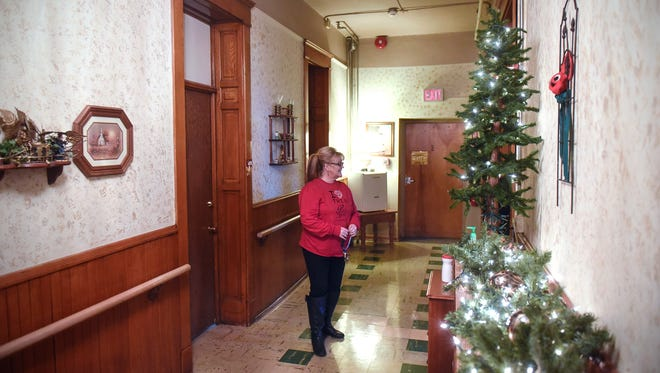 The Rev. Carol Smith walks down the hallway in the recently renovated Mary Anne's Wing Friday, Dec. 1, at the Place of Hope in St. Cloud. The wing is designed to house up to 12 single women.