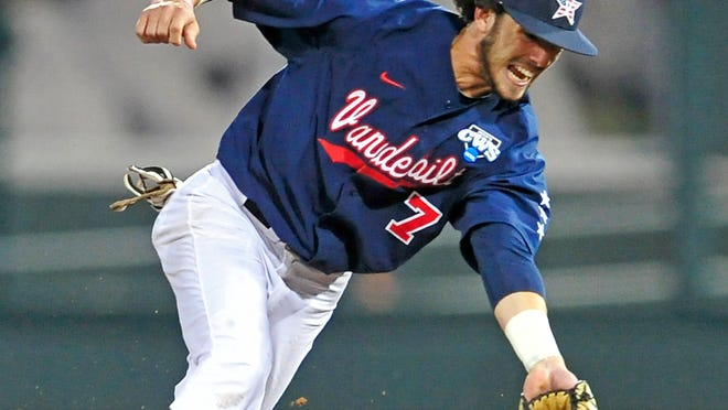 Vanderbilt second baseman Dansby Swanson fields a ground ball during the 5th inning against Virginia at the College World Series at TD Ameritrade Park in Omaha, Neb., Monday, June 23, 2014.