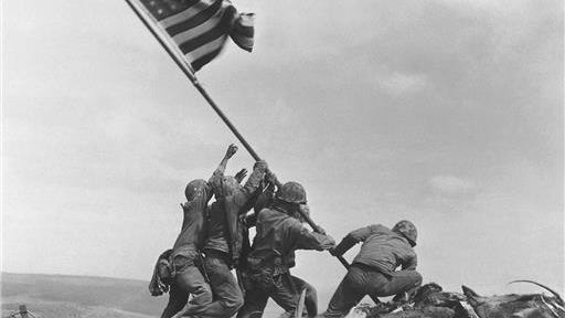 In this Feb 23, 1945, file photo, U.S. Marines of the 28th Regiment, 5th Division, raise the American flag atop Mt. Suribachi, Iwo Jima, Japan. The Marines Corps announced Thursday that one of the six men long identified in the iconic World War II photograph was actually not in the image. A panel found that Pfc. Harold Schultz, of Detroit, was in the photo and that Navy Pharmacist's Mate 2nd Class John Bradley wasn't in the image. Bradley had participated in an earlier flag-raising on Mount Suribachi.