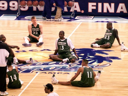MSU players stretch out before practice at Tropicana
