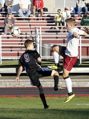 Taylor Grover of Odessa-Montour kicks the ball past
