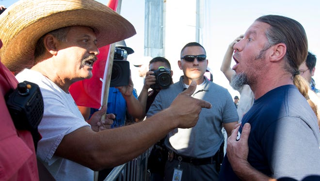 Jorge Soria (left) and Steve Kollmeyer argue after a rally for Donald Trump at Veterans Memorial Coliseum in Phoenix on June 18, 2016.