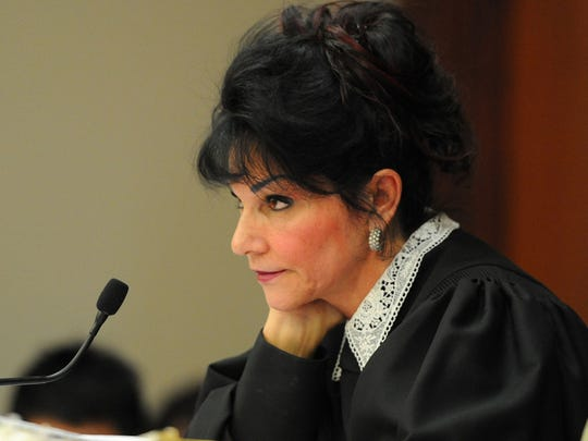Judge Rosemarei Aquilina looks at former USA Gymnastics doctor Larry Nassar as she sentences him to 40 to 175 years in prison on Wednesday, Jan. 24, 2018, in Lansing, Mich.