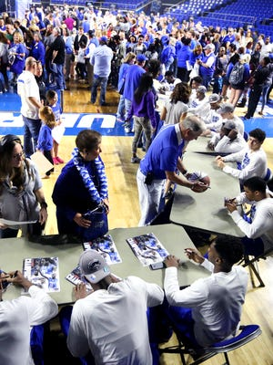 A sea of blue covered half of the the MTSU Murphy Center court on Wednesday, March 23, 2016., as MTSU fans stand in a long line to get Championship  posters autographed by the Men's and Women's team during a Championship celebration for both.