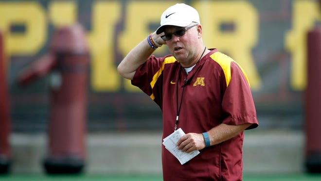 Minnesota football coach Jerry Kill watches his players during practice in Minneapolis on Aug. 7, 2015.