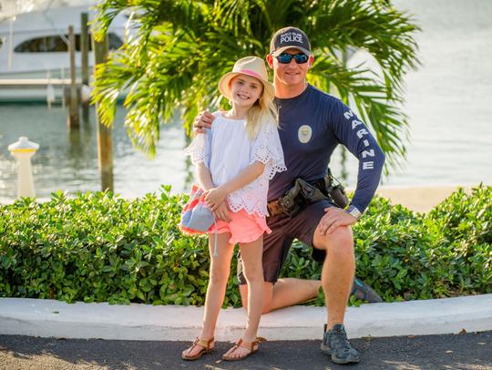 Paddler Josh Ferris, with Travis Suit's daughter Piper,