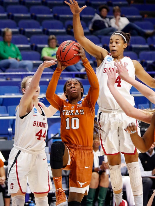 Texas' Lashann Higgs (10) shoots while defended by Stanford's Karlie Samuelson (44) and Erica McCall during a regional semifinal in the women's NCAA college basketball tournament in Lexington, Ky., Friday, March 24, 2017. Stanford won 77-66. (AP Photo/James Crisp)