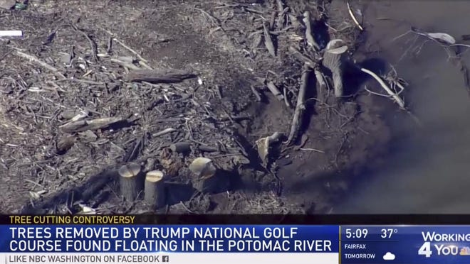 This image provided by WRC/NBC4 Washington on March 1, 2019, shows trees that were cut down at the Trump National Golf Course in Sterling, Va. County officials in northern Virginia say the Trump National Golf Club violated zoning laws by cutting down trees without a permit in a flood plain along the Potomac River.