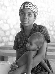 Haitian mother and baby at rural health clinic