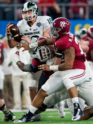 Michigan State quarterback Connor Cook (18)  is sacked by Alabama defensive lineman Jonathan Allen (93) and linebacker Ryan Anderson (22) during first half action in the Cotton Bowl on Thursday December 31, 2015 at AT&T Stadium in Arlington, Tx. (Mickey Welsh / Montgomery Advertiser)