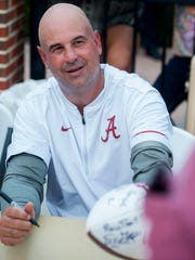 Alabama defensive coordinator Jeremy Pruitt signs autographs on fan day at Bryant-Denny Stadium in Tuscaloosa, Ala., on Sunday August 7, 2016.