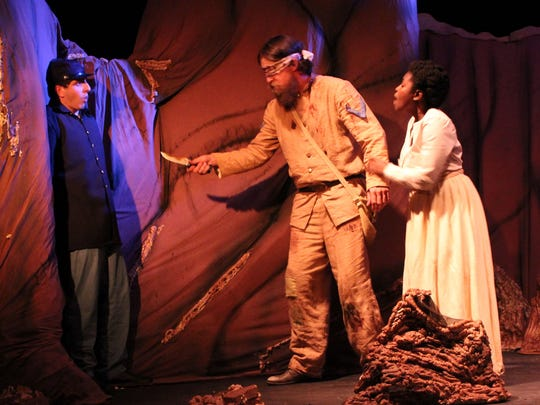 """(Left to right) Michael J. Pineda, Jordan Wilson and Marie Baptiste in a scene from Jeff Lindsay's """"The Cave"""" at Theatre Conspiracy."""