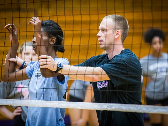 Coach Randy Gardner leads Central in a volleyball practice