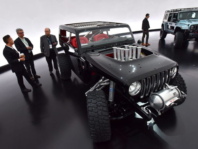 Jeep and Mopar employees mingle with the media around