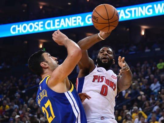 Pistons center Andre Drummond passes the ball against