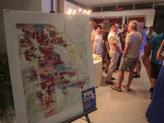 Red marks each representing a vacation rental in the City of PalmSprings on a map at the yes on Measure C election night party in Palm Springs on Tuesday, June 5, 2018. Early results shows no of Measure C ahead in the vote tally.