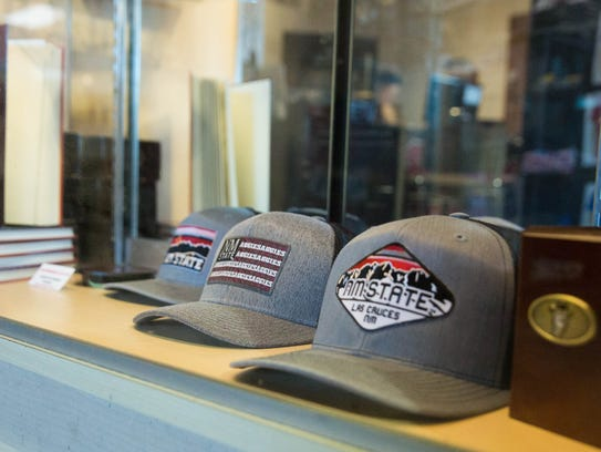 Hats, jerseys, T-shirts, banners and logos are all produced in-house at Sports and Accessories in Las Cruces.