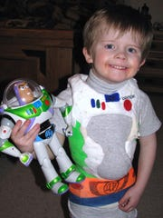 Noah with Buzz Lightyear toy. Physician assistants