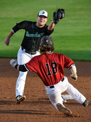 Steven Neutzling of the Beaudreau's  Saints makes a play at second base as Tyler Long of the Sauk Rapids Cyclones slides during the Friday, Aug. 12, game in Cold Spring.