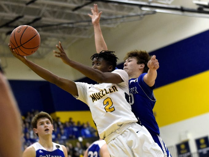 Moeller's Raymon Payton (2) powers his way to the basket.