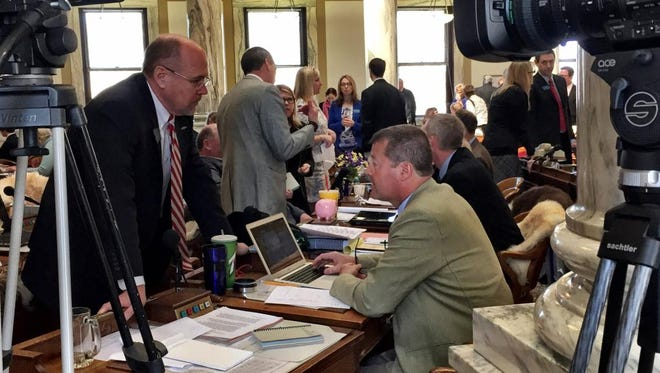 Rep. Art Wittich, R-Bozeman, confers with Rep. Albert Olszewski, R-Kalispell, as the House gridlocks on passing an infrastructure bill, which both voted no on.