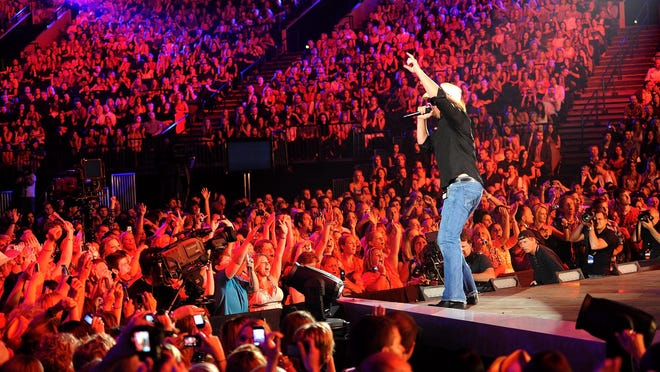 Keith performs on stage at the 2011 CMT Music Awards.
