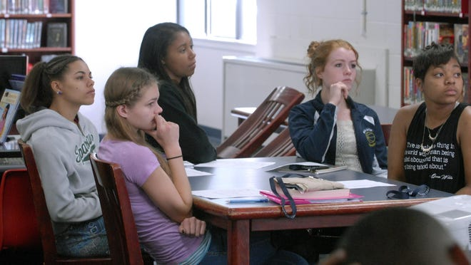 Baldwin high school students Makayla George, left, Alexis Mooney, Nia Freeman, Nicole Mooney and SheDorrius Scott listen to admissions specialists from Northwood University.