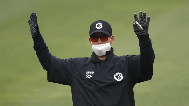 South Korea's baseball season began this week with umpires wearing a mask and gloves as a precaution against the coronavirus. The baseball games, the restart of NASCAR and MLS soccer players reporting to training are glimmers of hope for the sports world.
