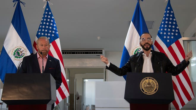 El Salvador's president Nayib Bukele, right, accompanied by US Ambassador to El Salvador Ronald Johnson, speaks during a joint press conference at Rosales Hospital in San Salvador on May 26, 2020.