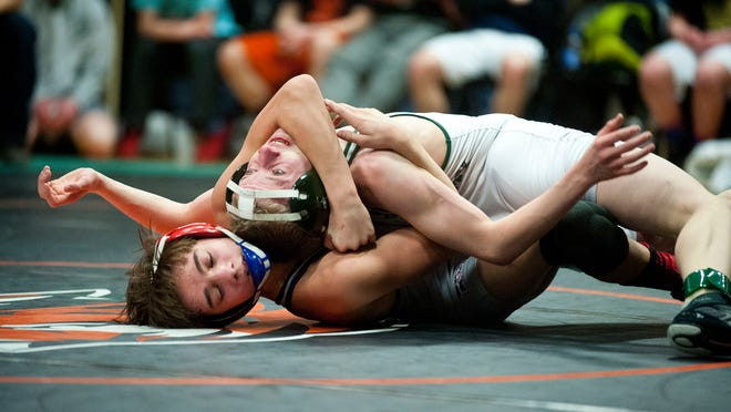 Mount Anthony's Ashdin Shaefer, bottom, works against St. Johnsbury's Issac Hahr during the 106-pound state championship on Saturday night at Middlebury.