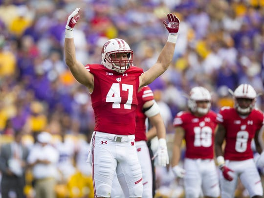 Badgers linebacker Vince Biegel fires up the crowd in a Sept. 3 game against LSU at Lambeau Field.