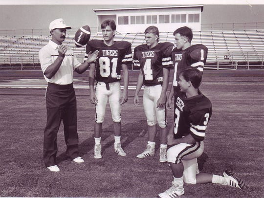 Breaux Bridge head coach Paul Broussard during his days as an assistant coach with such player as current baseball coach Kyle Cormier (4).