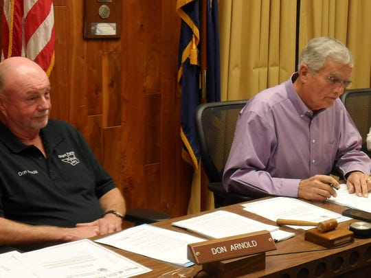 Grant Parish Police Jury President Arnold Murrell (right) and Juror Don Arnold listen to comments about open burning at Clean Harbors Colfax. The jury voted to oppose open burning of waste.