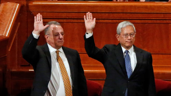 Ulisses Soares, left, of Brazil and Gerrit W. Gong, who is Chinese-American, join a panel called the Quorum of the Twelve Apostles at the start of a twice-annual conference of The Church of Jesus Christ of Latter-day Saints Saturday, March 31, 2018, in Salt Lake City. At the church conference this weekend in Salt Lake City, The Mormon church has made history and injected diversity into a top leadership panel by selecting the first-ever Latin American apostle and the first-ever apostle of Asian ancestry.