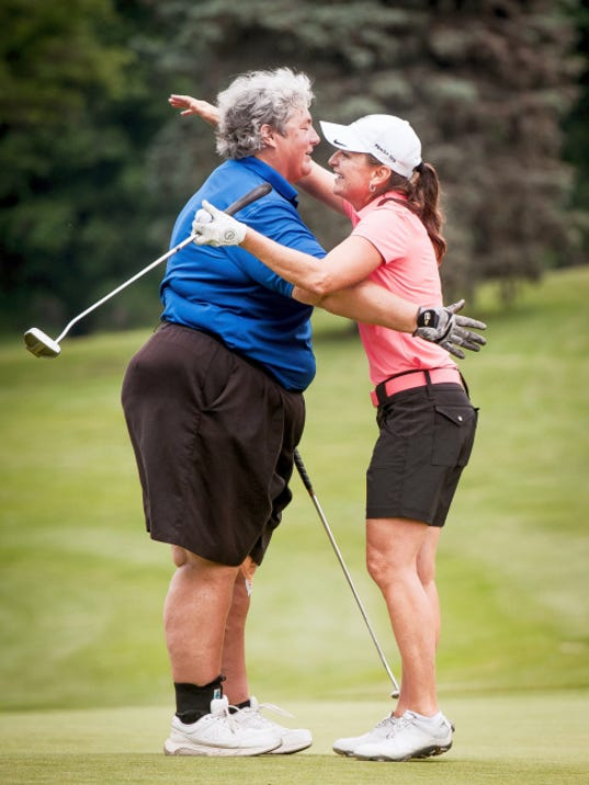 Maggie Ryan, left, hugs opponent Amy Kennedy on Thursday after Kennedy sunk the match-clinching putt on the 12th hole to win the Women's York County Amateur Golf Association Match Play Championship at Range End Golf Club in Dillsburg. Kennedy won her second straight match play title and seventh overall.