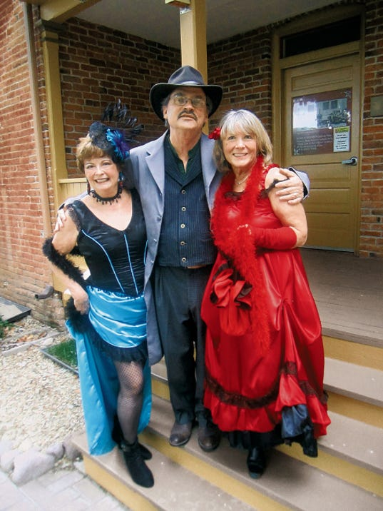 "Courtesy Photo   Silver City Rotarians Kathy Eaton, left, Tracy Spikes (executive director of the Silver City Museum) and Sunny Yates, don western wear to promote the Silver City Museum Society's Casino Night: ""An Elegant Evening in the Old West."""