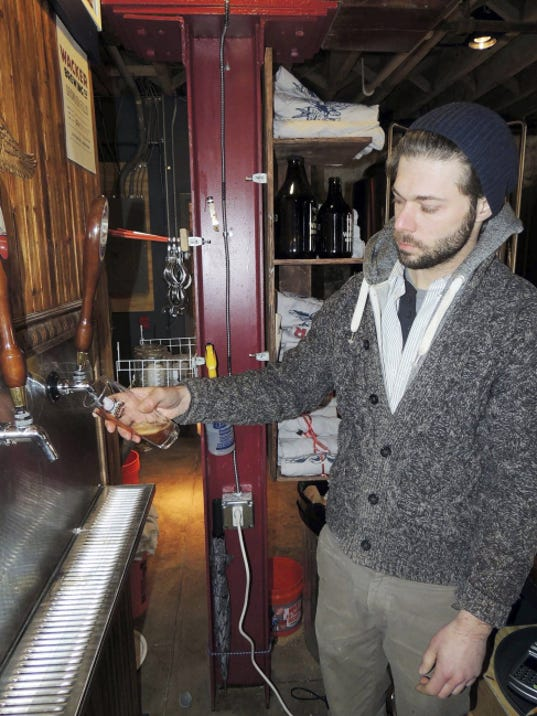 Michael Spychalski, head brewer and operations manager at Wacker Brewing Co. in Lancaster, taps a beer at the brewery.
