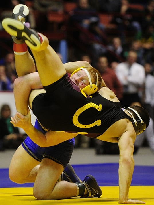 Kennard-Dale's Chance Marsteller, back, wrestles Governor Mifflin's Mike Shermot in the 160-pound bout of the District 3 Class AAA championships on Saturday at Hersheypark Arena. Marsteller won his second straight district title.