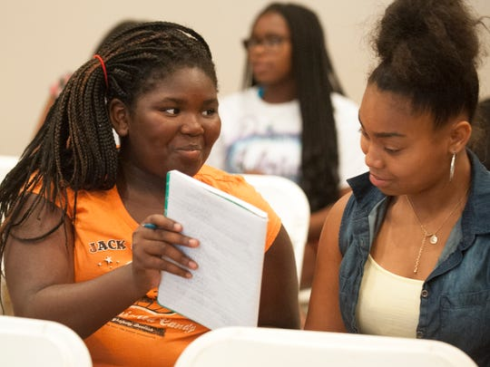 Eternity Easterling, 11 of Camden, left, and her cousin India Easterling, 13 of Camden, attend a youth entrepreneurship program led by Rashaan Hornsby, the president of the Centerville Simbas youth football program, a music promoter, and manager of his son, the Camden-based rapper Yung Poppa.