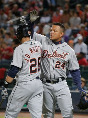 Tigers first baseman Miguel Cabrera (24) celebrates with J.D. Martinez (28) after hitting a two-run home run in the first inning Friday in Atlanta.