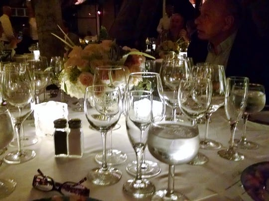 Tables were set with tea lights and assortment of glasses