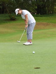 Misaki Kusuyama, 15, putts during the 7th Annual BMW